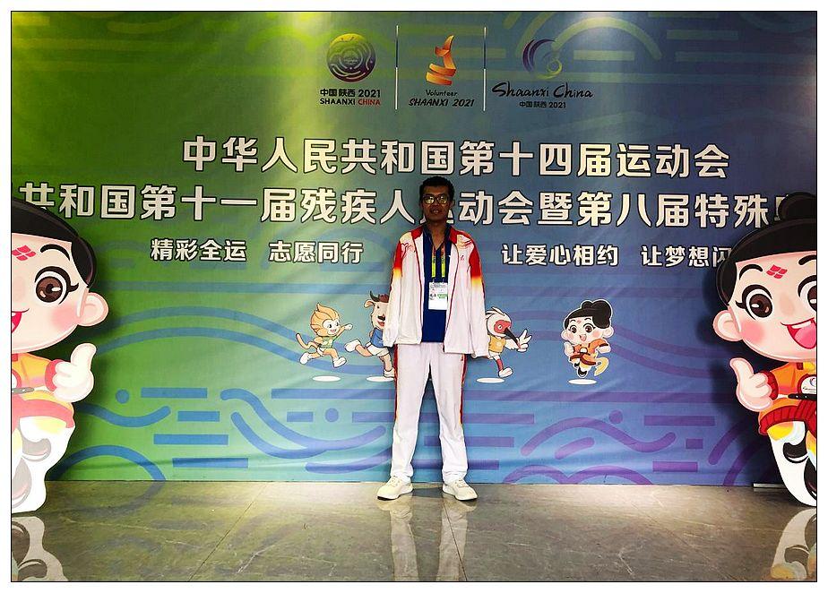 两届残运会季军王鹏是位无臂志愿者